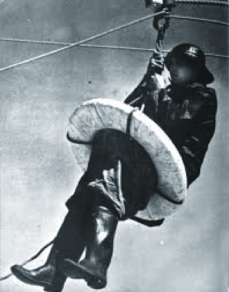 sailor in the lifering of a breeches buoy